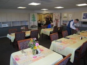 Scc dining room & Don setting up A